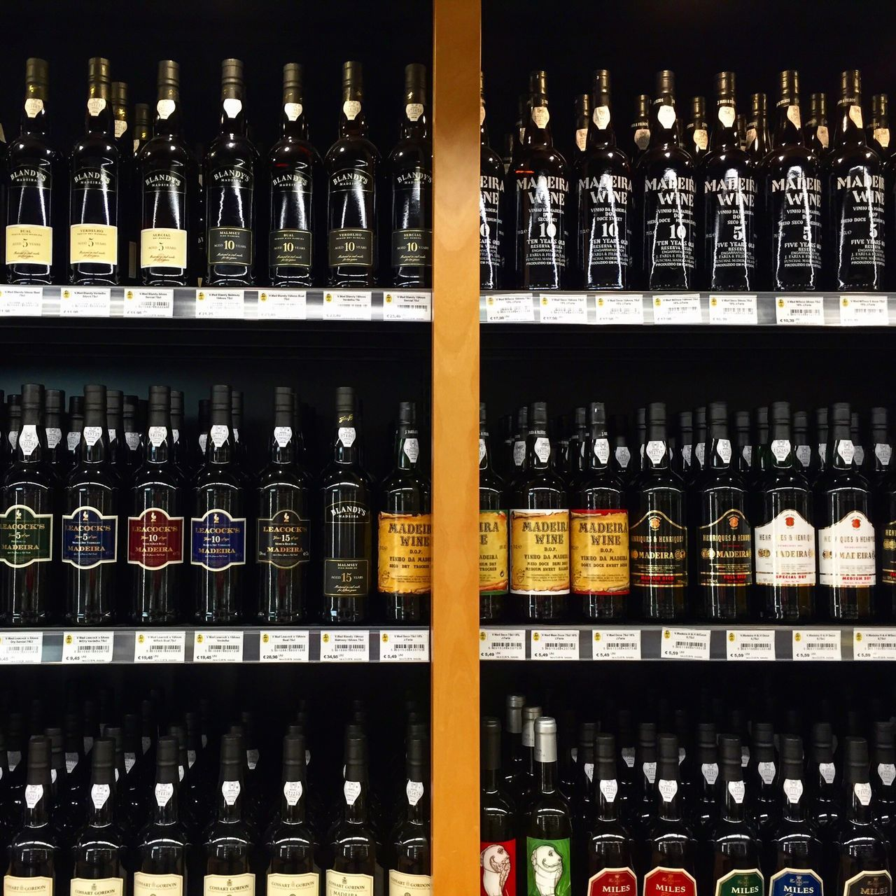 bottle, drink, shelf, alcohol, large group of objects, in a row, abundance, food and drink, order, indoors, refreshment, no people, arrangement, variation, wine bottle, choice, wine, food, day, liqueur, close-up