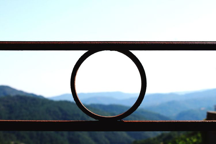 Close-up of railing against sky