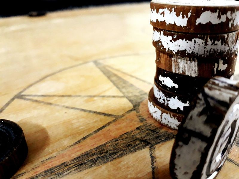 Carrom Coins. Coins On The Table Carromboard Carrom Coins EyeEm Selects Indoors  No People Close-up Day Indoors  Wood - Material Table