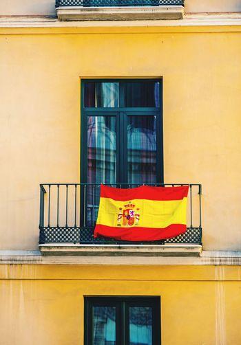 Flag Hanging On Balcony