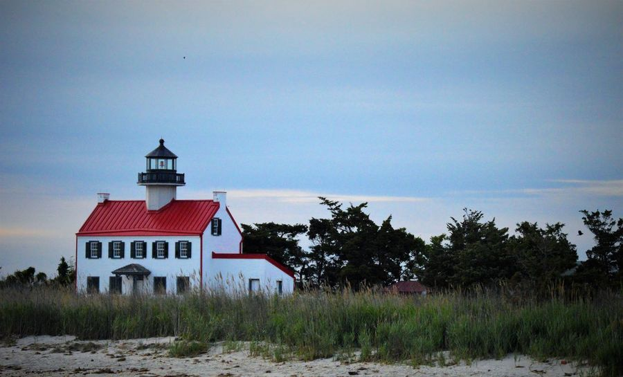 Dusk Sky Lighthouse Nature Bay Beach Day Grass No People Outdoors Red Roofs Reeds Religion Scenic View Sky Tall - High