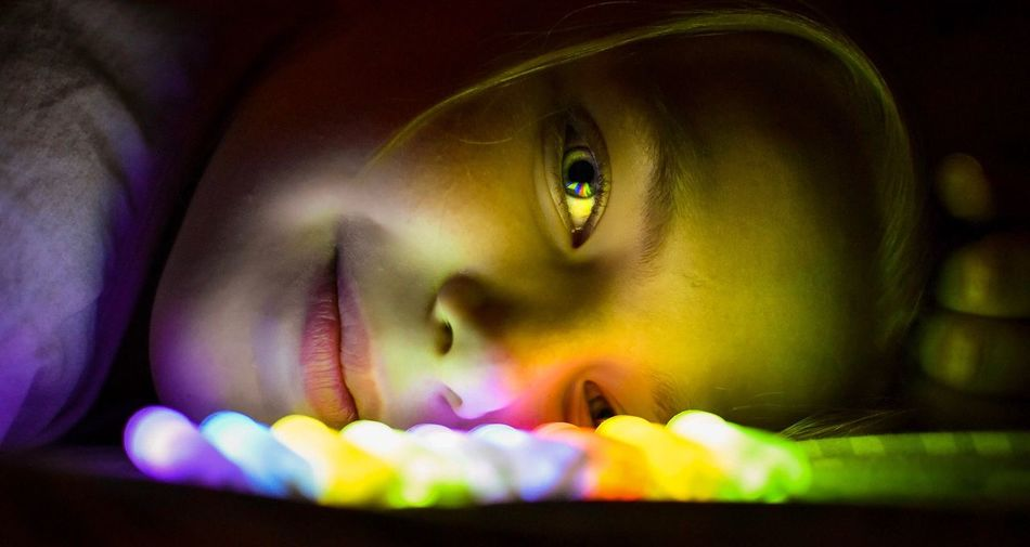Colorful One Person Real People Looking At Camera Colors Colour Colourful Glowing Glow Sticks Eye Reflection  Beautiful Human Eye Childhood Portrait Close-up Indoors  Eyelash Eyesight Day People light and reflection Paint The Town Yellow