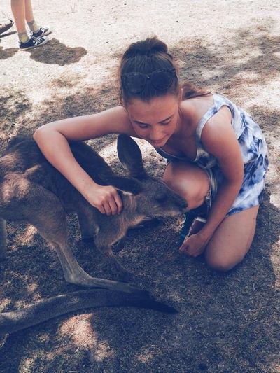 Portrait of woman embracing a kangaroo
