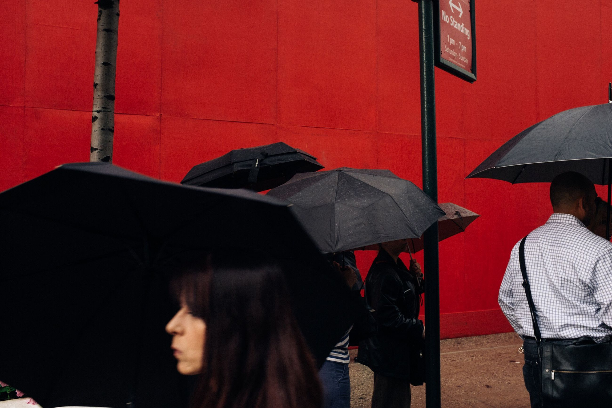 umbrella, rain, protection, weather, real people, wet, waiting, under, below, holding, red, outdoors, lifestyles, women, city, day