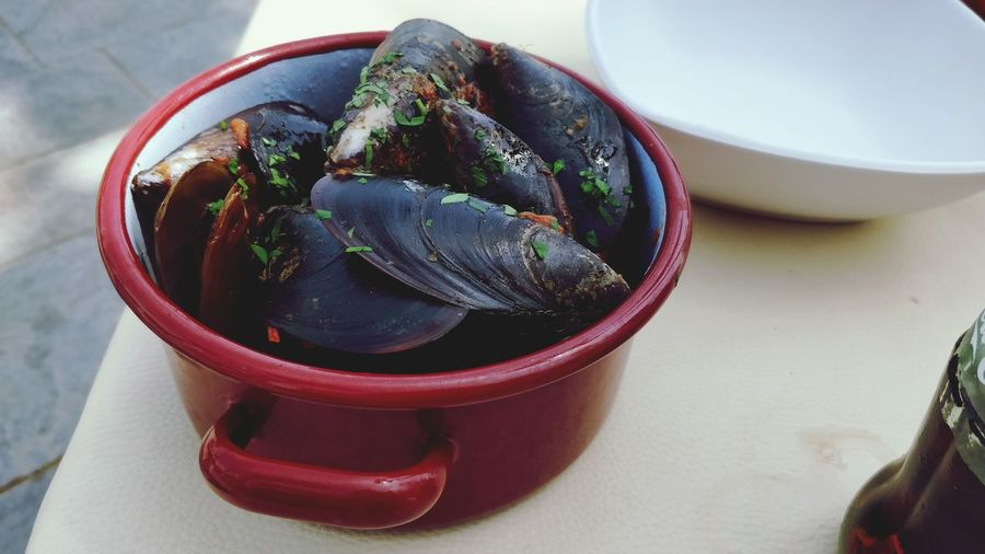 High angle view of mussels in bowl on table