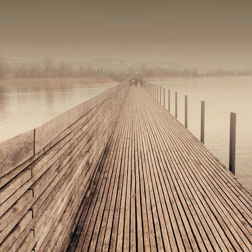 View of wooden pier in sea