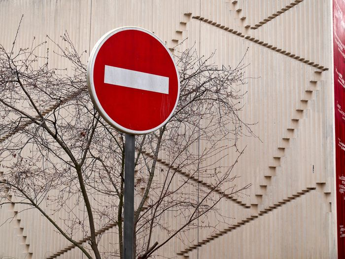 Low angle view of do not enter sign against building