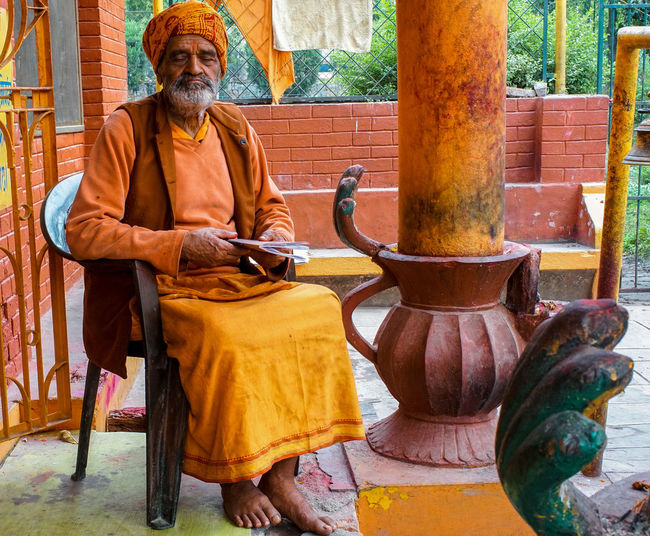 Sadhu with eyes closed sitting in temple