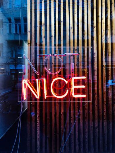 Illuminated neon with text on glass window