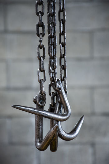 Close-up of chain hanging on wall
