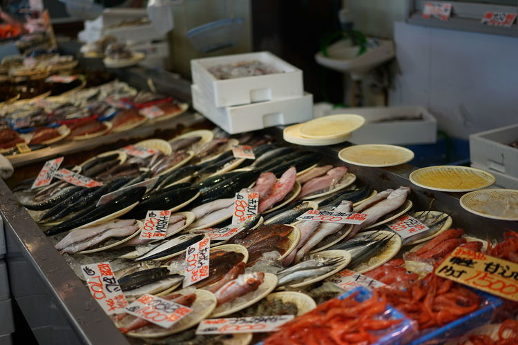 High Angle View Of Various Seafood For Sale At Market