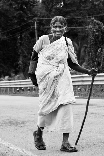 Full length portrait of woman standing outdoors