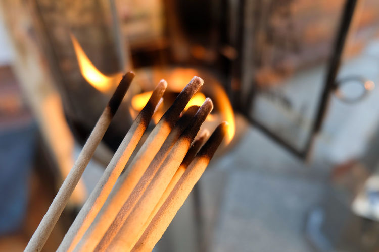 Close-up of incense sticks burning in temple