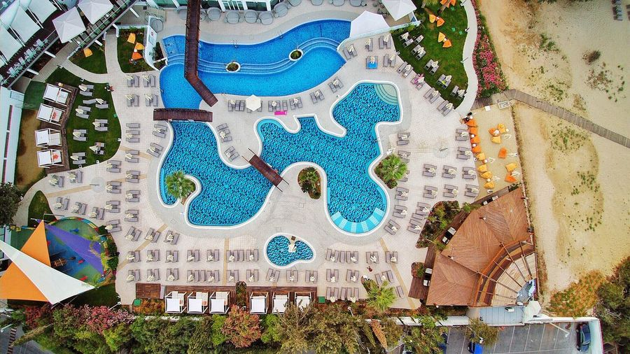 Flying High Swimming Pool Vertical Drone Photography Beach Hotel Resort Cyprus Architecture