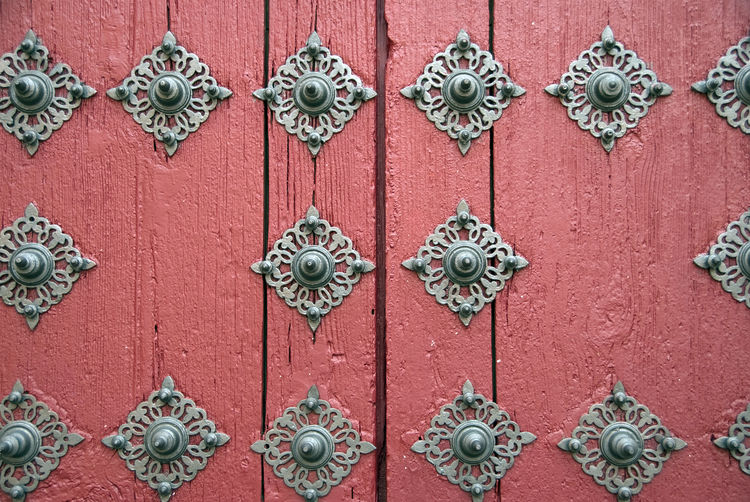 Gate Architecture Art And Craft Backgrounds Close-up Craft Creativity Day Design Entrance Floral Pattern Full Frame Metal Metallic No People Ornate Ornate Door Outdoors Pattern Protection Red Security Wall - Building Feature Wooden Wrought Iron