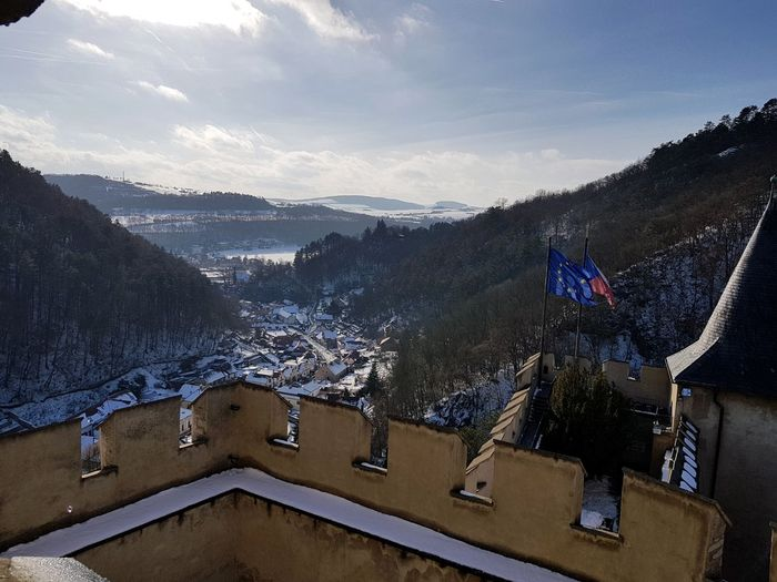 Panoramic shot of buildings against sky during winter