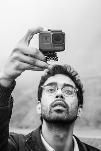 A teenager taking a wide angle shot on his GoPro Hero 5 Black. Young Adult Teenager Teenage Boys Spectacles Wearing Glasses Balckandwhite Portrait Friend Goproindia Goprohero5 Goprohero5black Small Yet Powerful India Indianphotographer