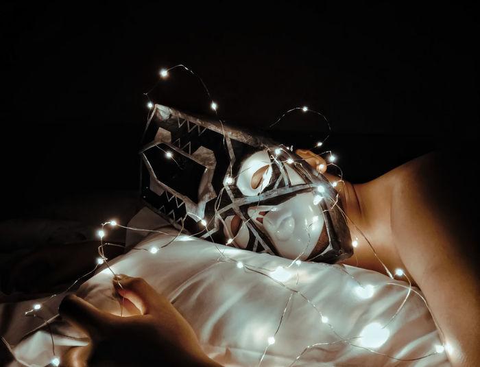 High angle view of hand on illuminated lighting equipment