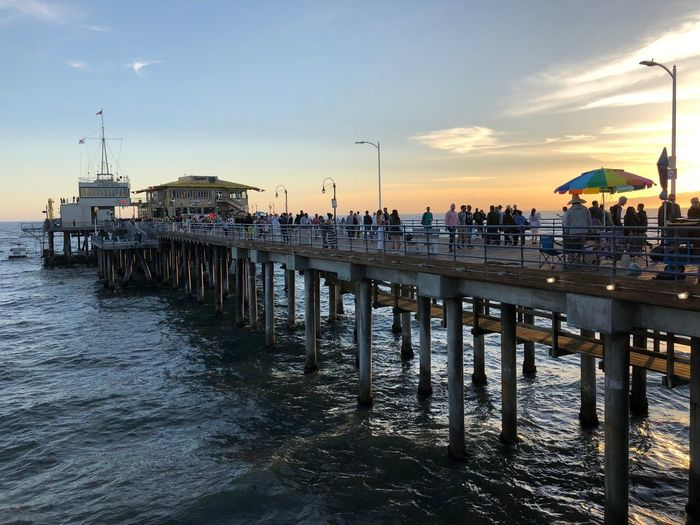 Pier On Sea Against Sky At Sunset