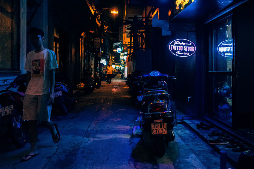 Walking by the Tattoo Shop Asian Culture Backyard Urban Exploration Architecture Building Exterior Built Structure City Full Length Illuminated Indoors  Men Neon Lights Night Nightlights Real People Store Street Sign The Way Forward