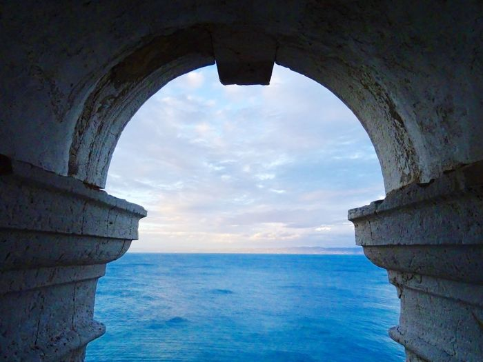 Medieval Frame EyeEm Best Shots Perfect Wide Keyhole Windy Outlook Sky Collection Perspective Framework Frame Blue Sky Medieval Architecture Water Sky Arch Sea Architecture Nature Cloud - Sky Blue Horizon Over Water History Horizon Architecture Outdoors