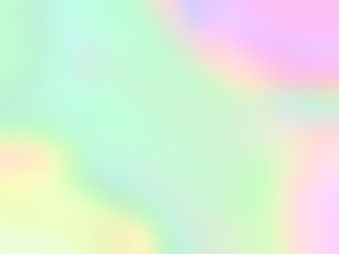 Defocused image of rainbow in sky