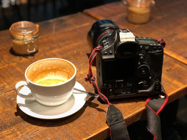 Photographer Life Canon Table Still Life Drink Technology Coffee - Drink Coffee Food And Drink Coffee Cup Cup Refreshment Mug High Angle View Camera - Photographic Equipment No People Indoors  Photography Themes Close-up Focus On Foreground Frothy Drink