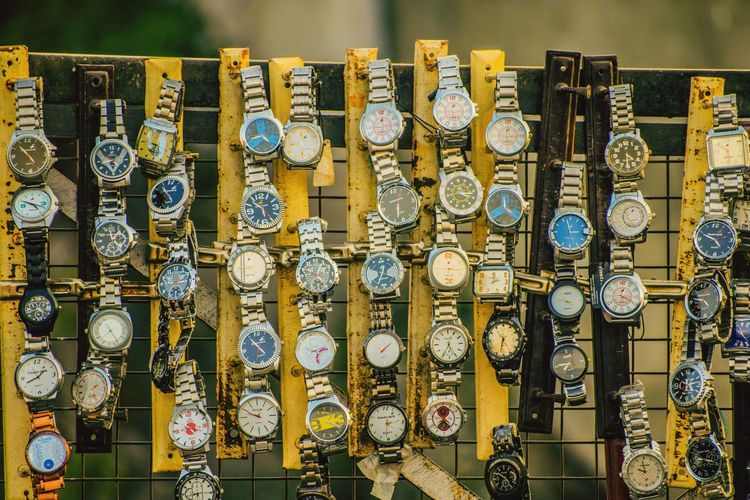 Wristwatch hanging in market for sale