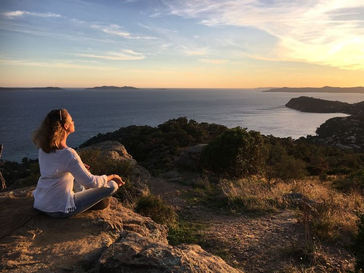 Sea Sitting Sunset Beauty In Nature Scenics Yoga Nature Tranquility Tranquil Scene Horizon Over Water One Person Rock - Object Cross-legged Sky Water Outdoors Full Length Mountain Real People Day At Ease Happiness Contented Côte D'Azur France