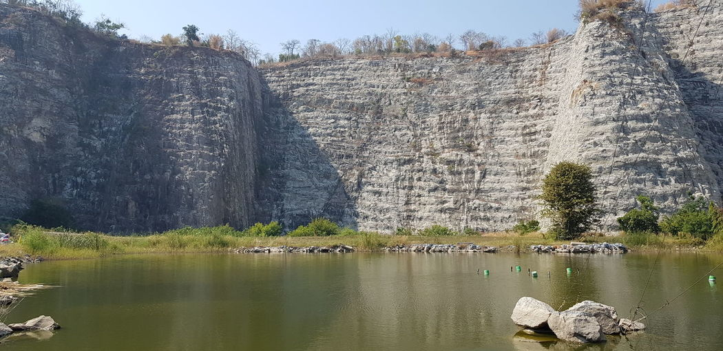 Scenic view of lake against rock formation