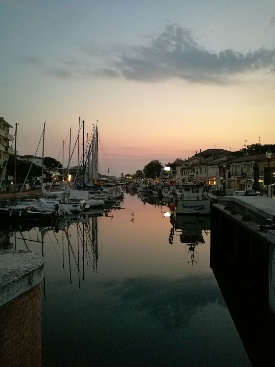 nautical vessel, water, reflection, moored, sunset, sky, transportation, mode of transport, boat, built structure, building exterior, architecture, outdoors, harbor, tranquility, nature, no people, sea, cloud - sky, tranquil scene, mast, travel destinations, beauty in nature, scenics, sailboat, yacht, day