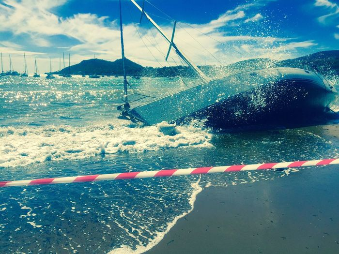 Capsized Yacht Beached Boat Beached Stranded Boat Stranded Sailing Accident Cordon Tape Cordonned-off Danger Yachting Mishap Beach Côte D'Azur French Riviera Luxury Yacht Plage Oops! Storm At Sea Sailing Dingy Tape Break The Mold Break The Mold The Week On EyeEm