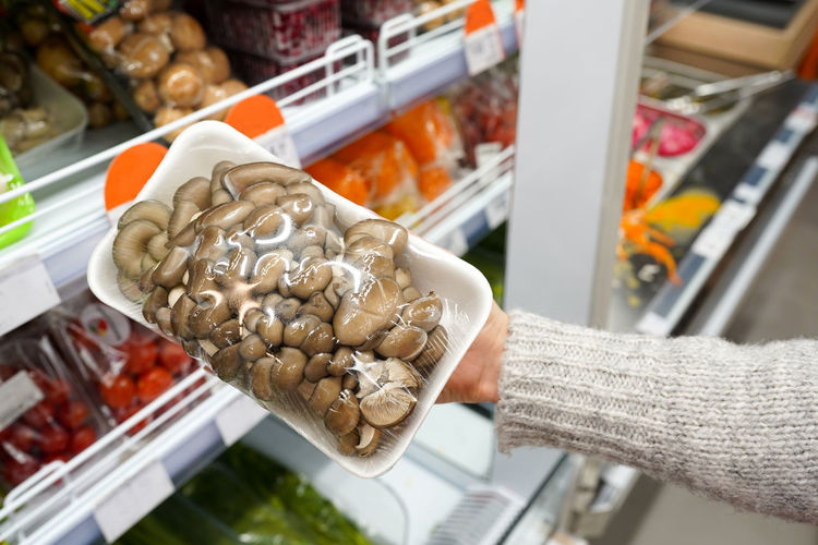 Close-up of hand holding food at market