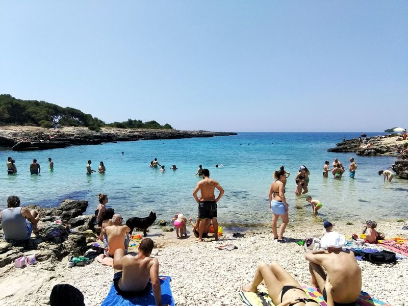 Beach Water Sand Sea Large Group Of People Summer Sky Vacations Nature Horizon Over Water Day Blue Outdoors Real People Lifestyles Men Women People Adult Clear Sky Salento Salento Puglia Italy Lecce Porto Selvaggio