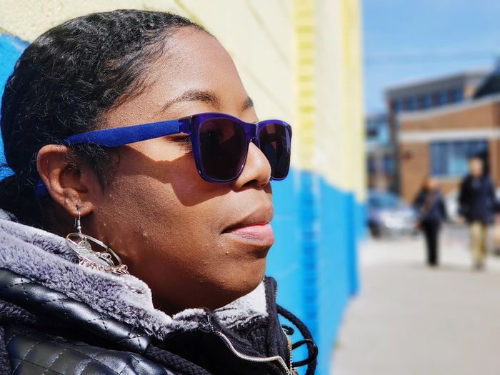 Close-up of woman wearing sunglasses and scarf