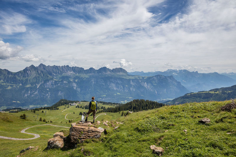 Hiking with the dog in Flums, Switzerland. Beauty In Nature Cloud - Sky Cloudy Day Dog Flums Grass Green Color Hiking Horizon Over Land Idyllic Landscape Mountain Mountain Range Nature Outdoors Physical Geography Rock - Object Sky Switzerland Tourism Tranquil Scene Tranquility Travel Destinations Woman
