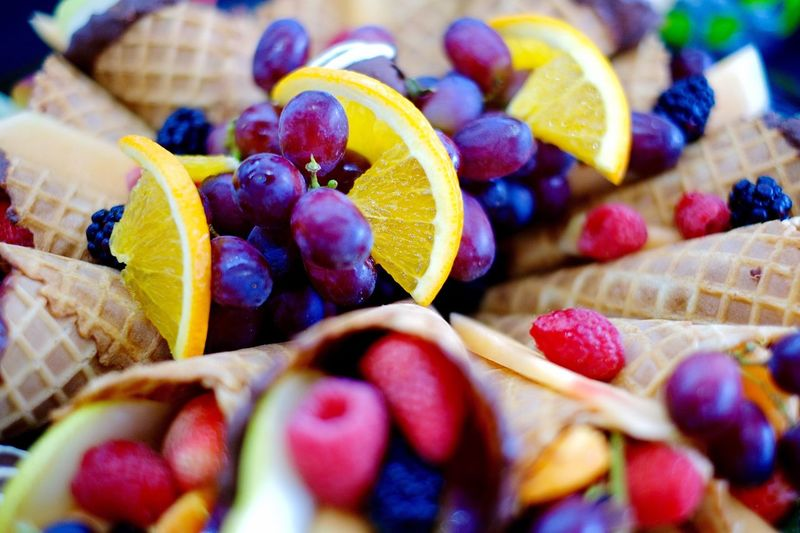 Full frame shot of various fruits in ice cream cone