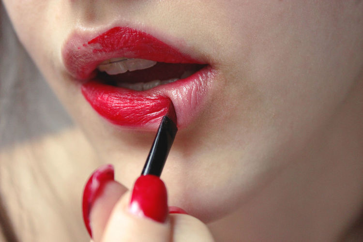 Close-Up Of Woman With Red Lipstick