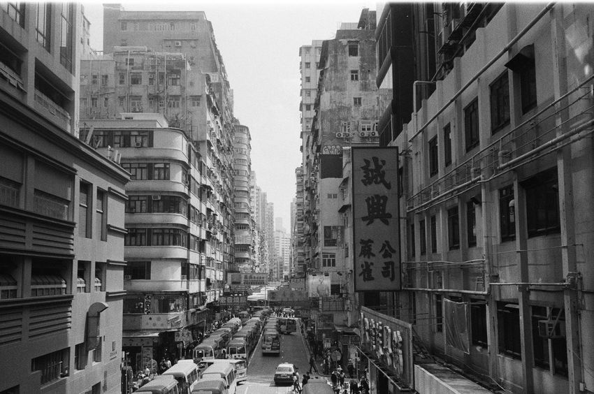 HongKong Architecture Blackandwhite Building Building Exterior Built Structure Busy Car City City Life Day Film Photography Filmisnotdead Filmphotography Land Vehicle Mode Of Transportation Motor Vehicle Outdoors Real People Residential District Road Street Street Photography Streetphotography Transportation
