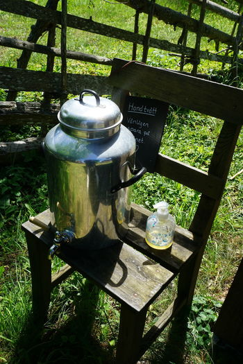 Wash your hands, but save water!! Bunge Bunge Museum Camping Stove Chair Clean Cleaning Day Drink Folk Museum Food And Drink Gotland Grass No People Outdoors Save Water Soap Sweden Table Teapot Tree Wash Washing Water
