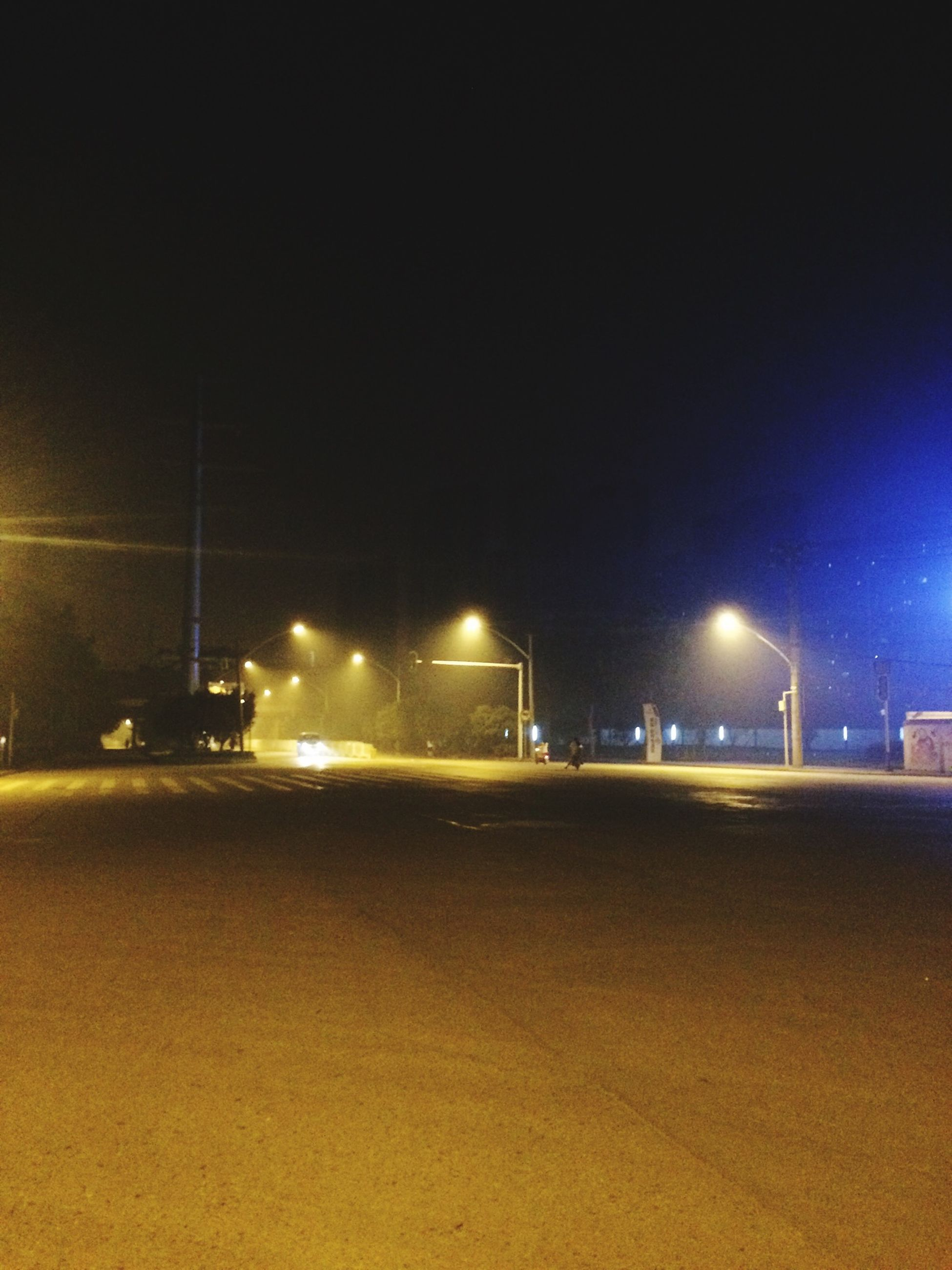 illuminated, night, street light, lighting equipment, transportation, copy space, clear sky, street, road, light - natural phenomenon, empty, sky, outdoors, the way forward, electric light, mode of transport, electricity, no people, city, dark