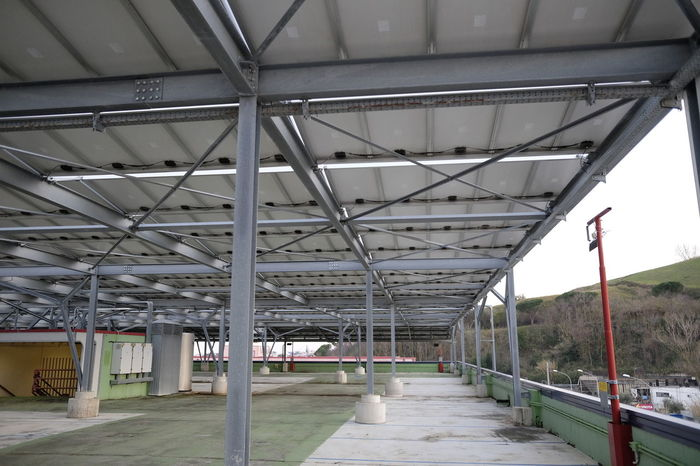 parking mall covered with solar panels Industrial Panel Power Solar Alternative Architecture Built Structure Covered Empty Energy Innovative Lot Mall Metal Parking Shopping Mall Steel