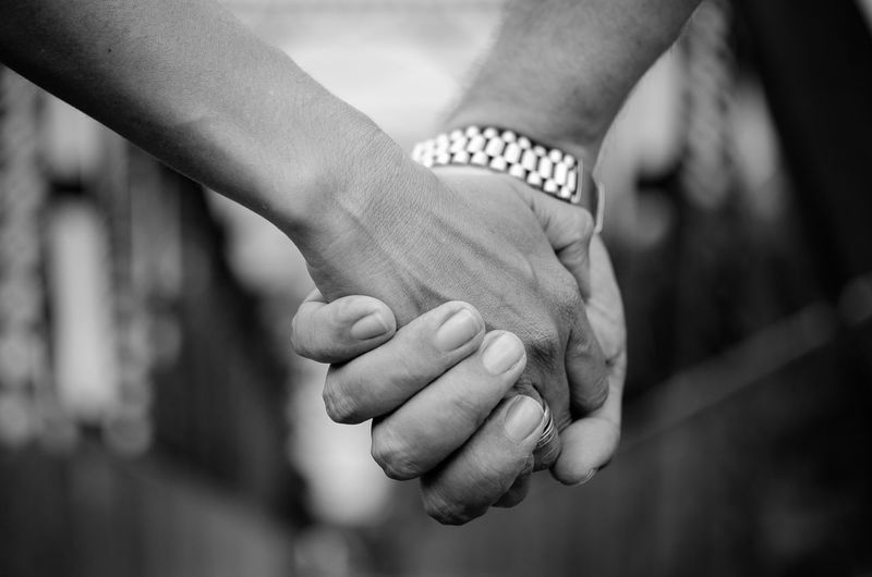 Close-up of couple with holding hands
