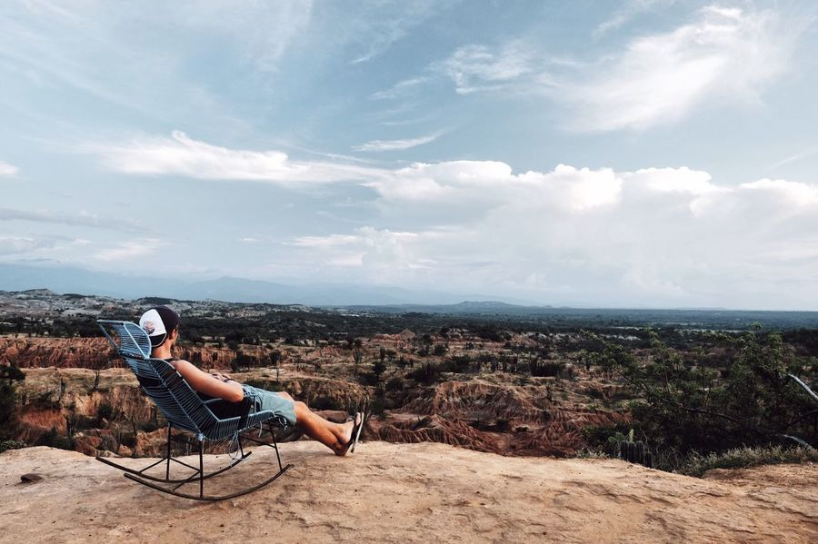 Finding New Frontiers Sky Real People Leisure Activity Sitting One Person Full Length Lifestyles Cloud - Sky Outdoors Scenics Day Landscape Nature Women Young Adult Beauty In Nature Young Women Hot Pants Desiertodelatatacoa Desert Alone Colombia