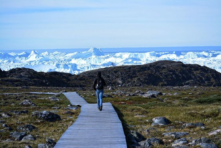 hiking on boardwalk in Ilulissat Greenland - beautiful icebergs in the Disko Bay / Baffin Bay - nature, rocks, blue sky, ice sea Greenland Ice Landscape_Collection Adventure Beauty In Nature Boardwalk Day Hiking Iceberg Landscape Mountain Nature Outdoors Rear View Rocks Scenics Sea Sky Tranquil Scene Women The Traveler - 2018 EyeEm Awards