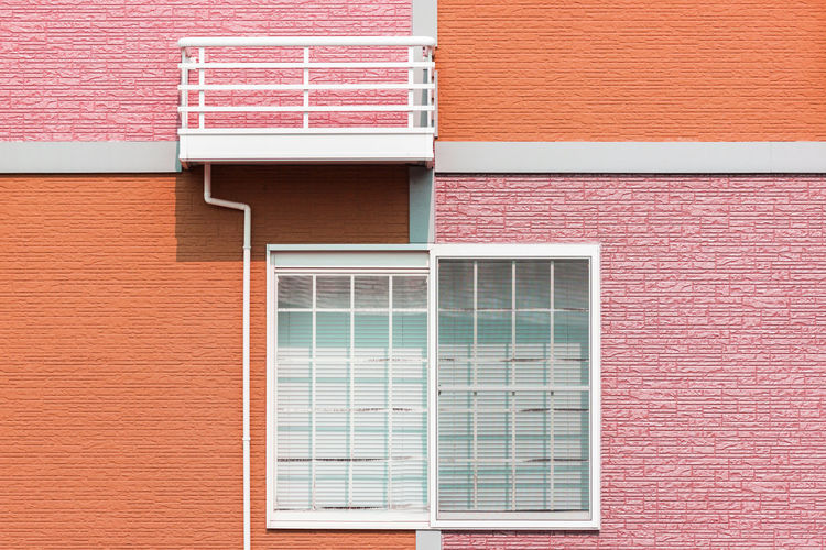 Exterior home design by colorful wall and window