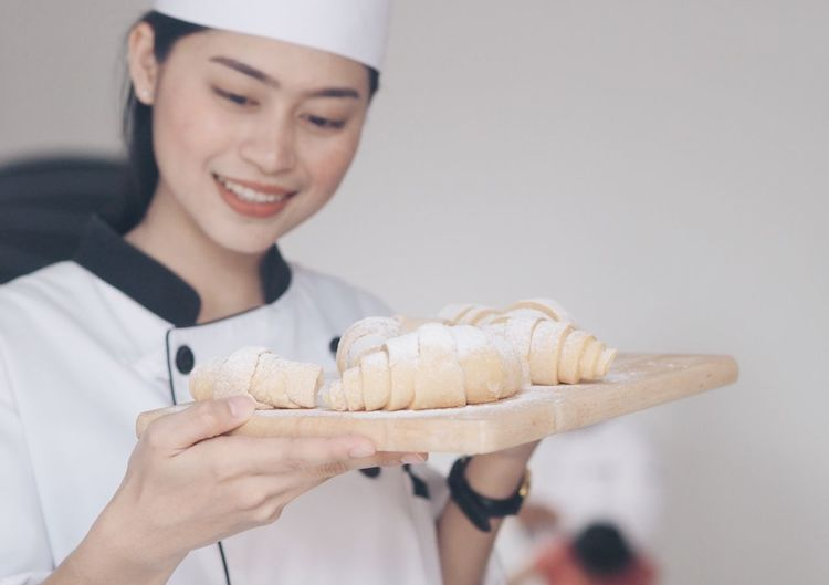 Smiling Female Chef Holding Food