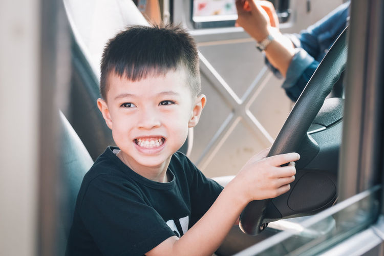 Childhood Real People Mode Of Transportation Looking At Camera Lifestyles Land Vehicle Leisure Activity Car Motor Vehicle Vehicle Interior Boys Child Men Portrait Males  Transportation Casual Clothing People Headshot Innocence Outdoors