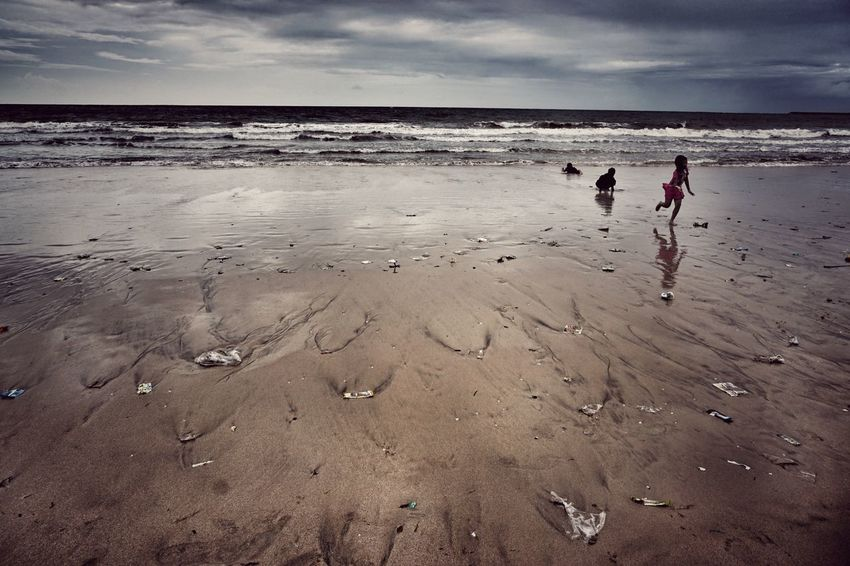 Jimbaran Beach Sand Ocean Trash Horizon Over Water Lifestyles Nature Shore Copy Space Bali Finding New Frontiers Apocalyptic Kids Playing At The Beach Garbage