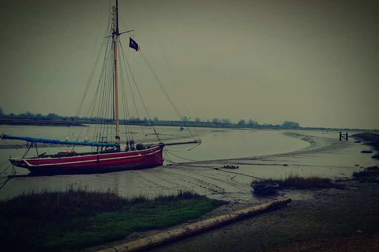 Where I Grew Up Red Boat Sailboat Boat Boats Boat Mast Mast Flag Flags In The Wind  Estuary Mud Muddy Squelchy Mud United Kingdom Nikon D3200